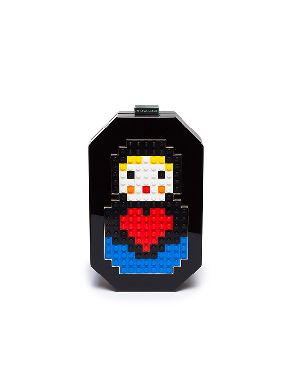 клатч из плексигласа, декорирован матрешкой из деталей Lego артикул JNB-P1 марки Les petits joueurs купить за 26000 руб.
