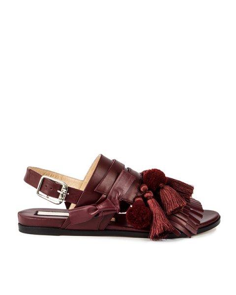 сандалии из натуральной кожи, декорированы кисточками, помпонами и бахромой артикул 8829 марки № 21 купить за 27000 руб.