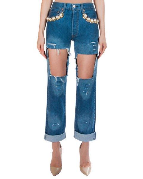 джинсы из плотного денима, декорированы вырезами; карманы украшены крупными бусинами и цепью артикул FCSS1601 марки Forte Couture купить за 21300 руб.