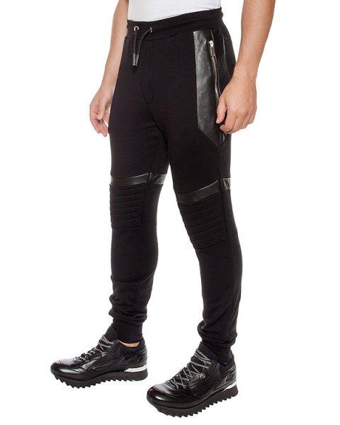 брюки из хлопкового трикотажа с кожаными вставками артикул LHB871A марки Les Hommes купить за 37000 руб.